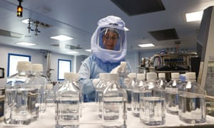 Employees in special suits test the procedures for the manufacturing of the messenger RNA (mRNA) for the Covid-19 vaccine in German company BioNTech, in Marburg, Germany on March 29, 2021.