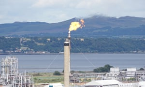 Gas flare at the Ineos plant in Grangemouth in the Midland Valley, Scotland.