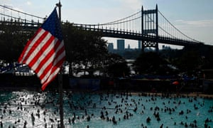 People enjoy the Astoria Pool on a hot afternoon in Queens, New York City.