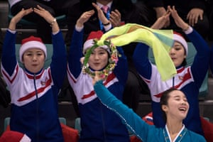 North Korean cheerleaders attend the women's preliminary round ice hockey match between Sweden and Unified Korea.