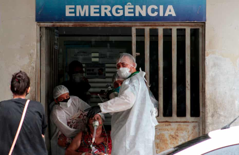 Health workers bring a patient in the Emergency room of the public hospital in Manacapuru, Amazonas state, on 20 January.