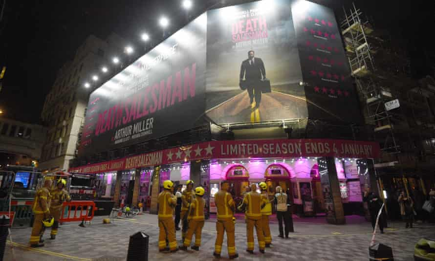 Firefighters outside the Piccadilly theatre after it was evacuated when part of its ceiling crashed down into the auditorium during a performance of Death of a Salesman