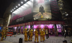 Firefighters outside the Piccadilly Theatre after it was evacuated.