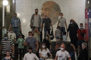 People wearing face masks walk in front of a portrait of Soviet Union founder Vladimir Lenin at the Metro station Biblioteka Lenina in Moscow, Russia, on 18 June 2021. Over the past 24 hours, 9,056 cases of Covid-19 coronavirus infection have been detected in Moscow, which is a new record since the beginning of the pandemic.