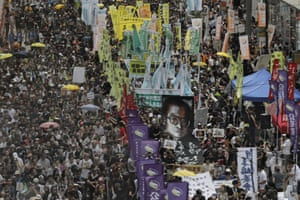 Hong Kong pro-democracy protesters carry a large image of Liu Xiaobo on 1 July