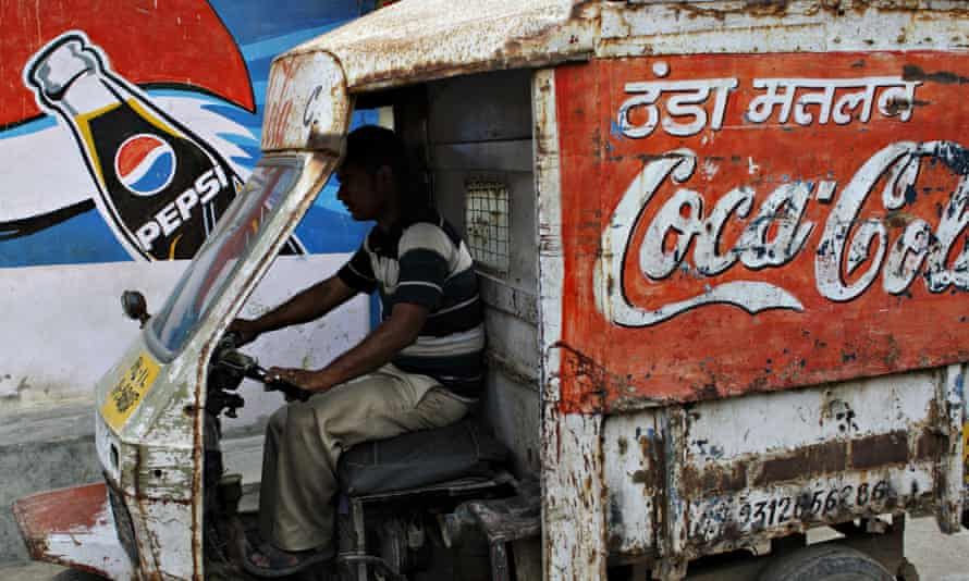 A drinks delivery driver in the suburbs of New Delhi.