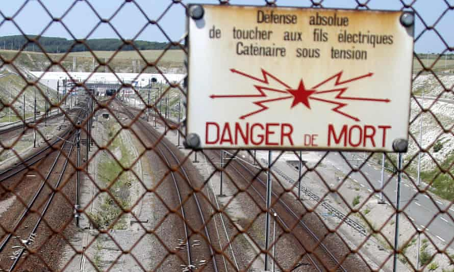 A poster warns of the danger of death above the railway line near the Channel tunnel in Calais.