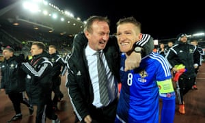 Michael O'Neill, here celebrating with his captain Steven Davis, has a contract with Northern Ireland that runs only until the end of next summer's tournament.