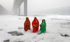 Hindu women had to immerse themselves into the polluted waters of the Yamuna River.