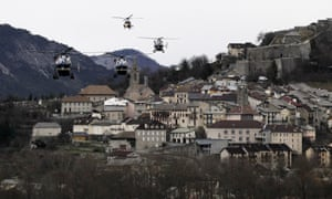 Helicopters of the French gendarmerie and emergency services fly over Seyne-les-Alpes as they resume works to recover the bodies and the remains of the victims