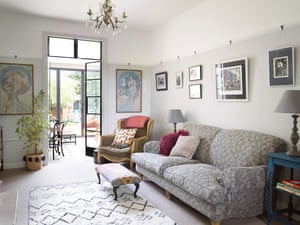 Upcycled style: charity shop Mucha prints, a hand-me-down sofa and re-covered footstool .