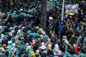 Indonesian students participate in a demonstration against the exploration of the Leuser Ecosystem area by mining companies, in Banda Aceh