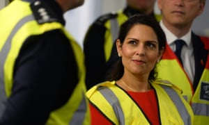 The home secretary, Priti Patel, with border officials at the Port of Dover.