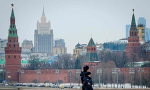 A pair of police officials patrol on a bridge outside The Kremlin in Moscow