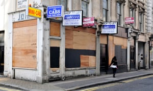 Boarded-up shops in central London, where business has been declining.