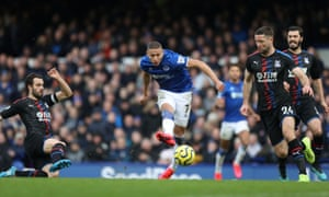 Everton's Richarlison curls the ball home.