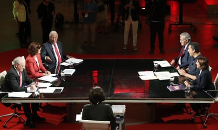 Party leaders sit around large table on TV set