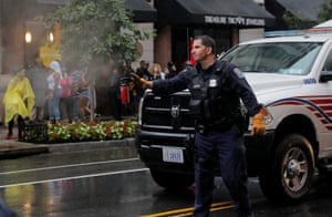 A police officer uses pepper spray