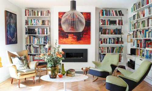 Vintage 'Penguin' chairs designed by Theo Ruth were reupholstered in Arne Jacobsen fabric. The painting above the fireplace is by the owner's mother, artist Mariana Rebolledo (marianarebolledo.com).