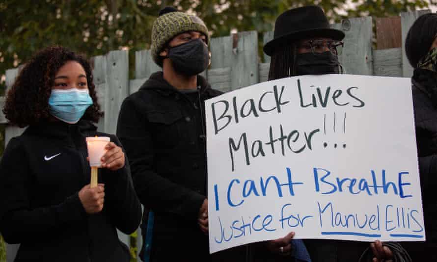 People listen during a vigil for Manuel Ellis in Tacoma, Washington, on 3 June.