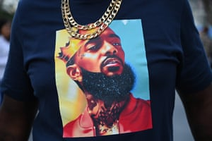 A fan at the memorial service wears a shirt with an image of Nipsey Hussle.