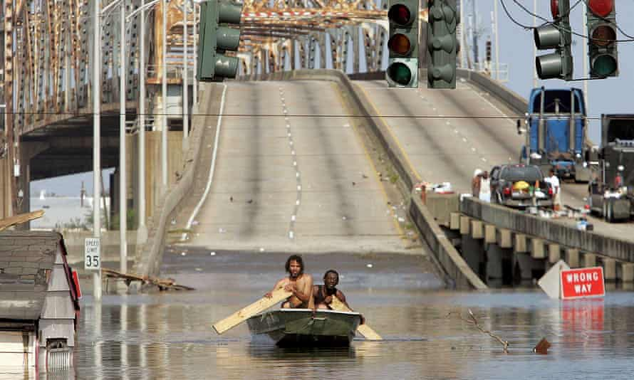 Two men paddle through New Orleans in the aftermath of Hurricane Katrina