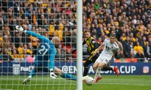 Gerard Deulofeu rolls home Watford's winning goal in the FA Cup semi-final against Wolverhampton.