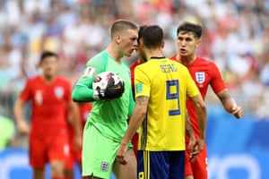 Jordan Pickford of England confronts Marcus Berg of Sweden.