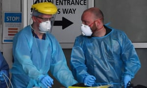 Staff wear personal protective equipment (PPE) as they work at the Royal Liverpool Hospital in Liverpool