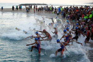 Ashkelon, Israel: People jump into the sea as they take part in a triathlon