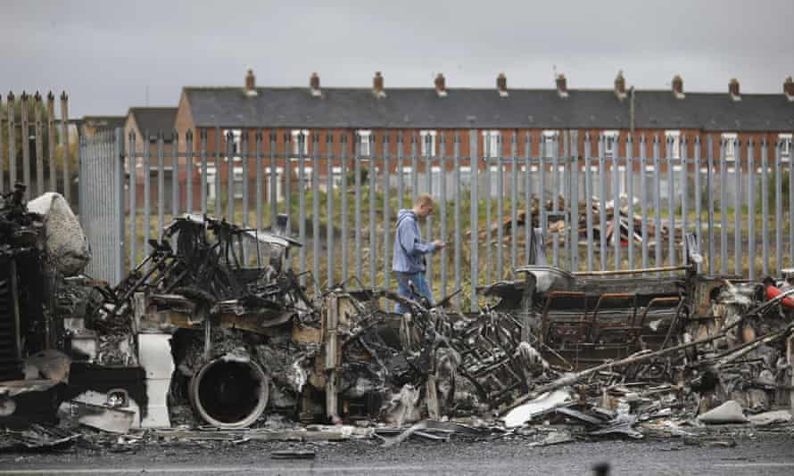 A burnt-out bus on the Shankill Road in west Belfast.