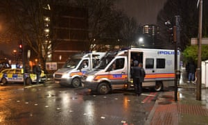 Police at the scene of a fatal stabbing in Battersea, south London, 5 February.