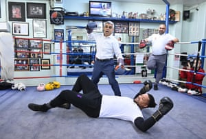 London, UKThe incumbent and Labour candidate for the London Mayoral election Sadiq Khan (C) poses with British boxer Joe Joyce (on the canvas) during a campaign event at Earlsfield Boxing Club