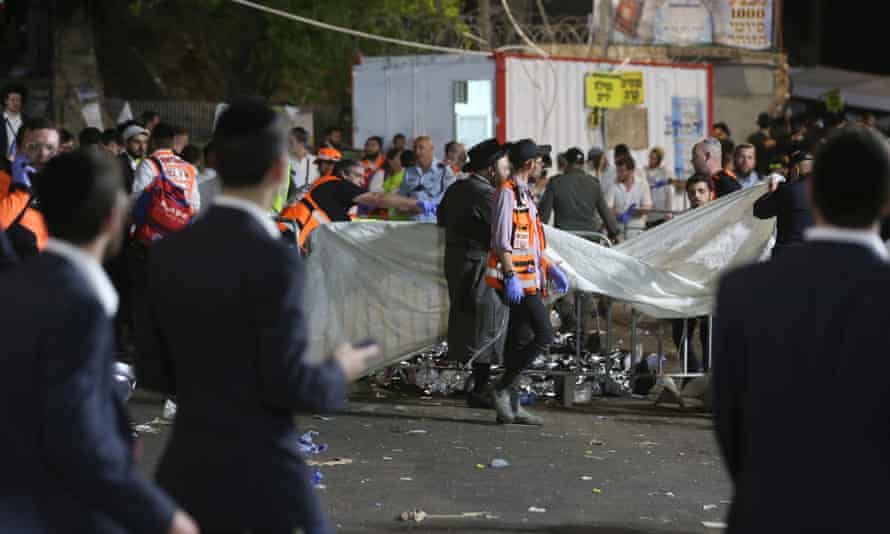 Israeli security forces and rescue workers search the bodies of dozens of ultra-Orthodox Jews who were killed during a beating on Mount Meron in Mount Meron.