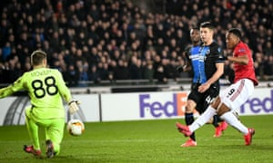 Anthony Martial slots the equaliser past Simon Mignolet