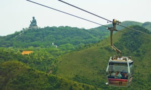 The Ngong Ping Cable Car, Big Buddha statue in the distance.
