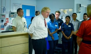 Boris Johnson speaks to medical staff during a visit to Watford general hospital, following an announcement on funding for the NHS.