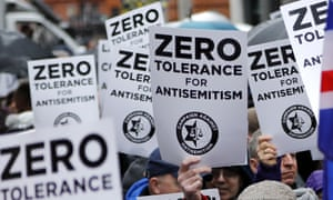 People hold up placards at an antisemitism protest in London this year.