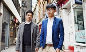 Wong (right) with Nathan Law