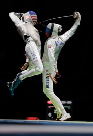 Miles Chamley-Watson of USA leaps at Artur Akhmatkhuzin of Russia during the men's team foil fencing semi-final match
