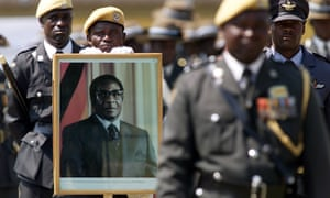 Portraits of Robert Mugabe have been ubiquitous, as in this armed forces day parade in 2003.