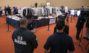 US marshals keep watch on a room full of personal items belonging to James 'Whitey' Bulger and Catherine Greig.