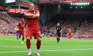 Xherdan Shaqiri leads the celebration after his ball led to the own goal that opened the scoring.