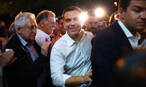 Alexis Tsipras arrives at the headquarters of his Syriza party after exit polls suggested