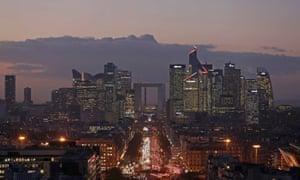 Sun sets over skyscrapers in La Defense, Paris