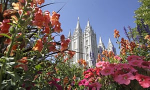 Flowers bloom in front of the Salt Lake Temple in Salt Lake City. The Mormon church announced that it would be appointing women to its councils for the first time.