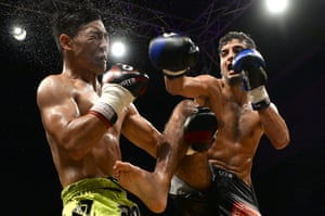 Moroccan fighter Youssef Haji, right, fights Lu Jiambo of China back at the Grand Prix Majesty Mohammed VI Championship (Kick Boxing) Fight Night event in Tangier
