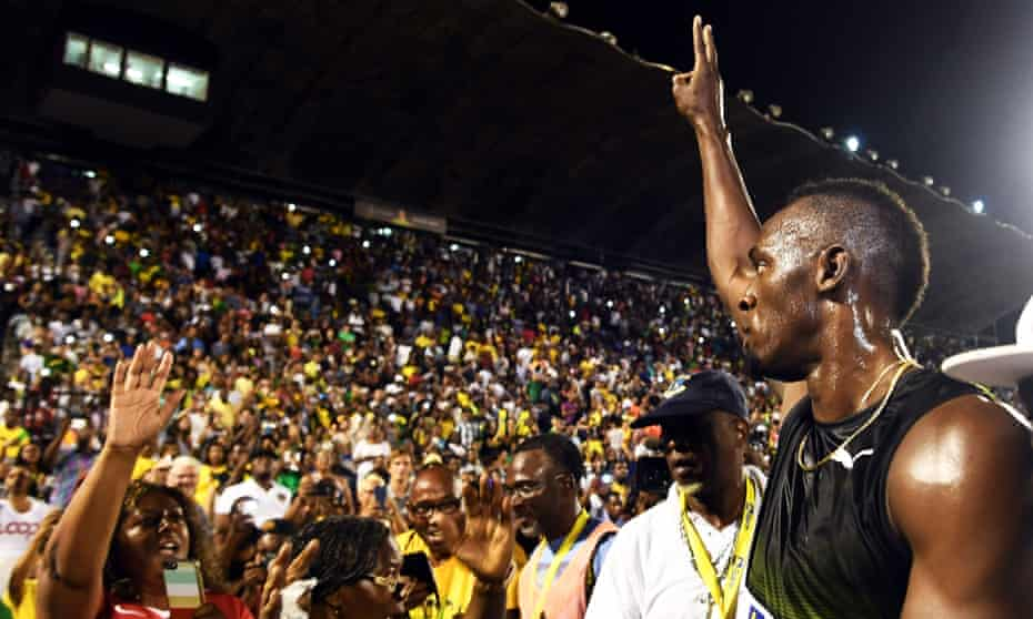 Usain Bolt salutes the crowd after running his final race in his home country, Jamaica, last week. Bolt partied with his devoted fans in an emotional farewell.