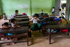 Students play in a classroom in Yangon, Myanmar