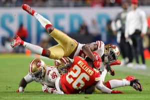 Damien Williams of the Kansas City Chiefs is tackled hard.
